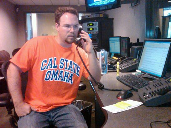 Jim Rome Show Producer Jason Stewart wears his Cal State Omaha shirt on casual Friday